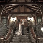 Bride and groom under the arch at Tewksbury Country Club