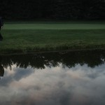 Romantic photo of Bride and Groom with reflections in the pond