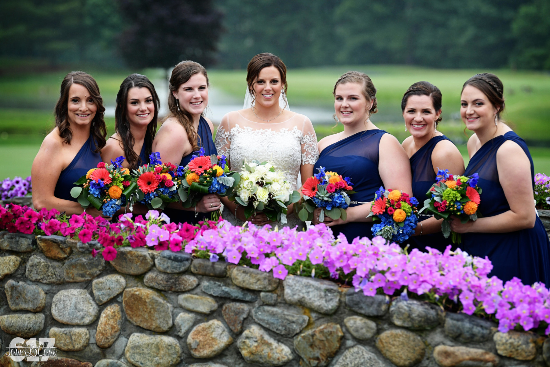 Bridal Party on Stone Bridge with Petunias at Tewksbury Country Club