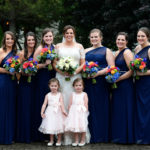 Bride, Bridesmaids, Maid of Honor, Flower Girls on Stone Bridge